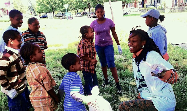 Felicia Andrews (right) working with children in the neighborhood