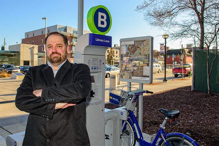 Clean Energy Coalition executive director Sean Reed at an ArborBike station