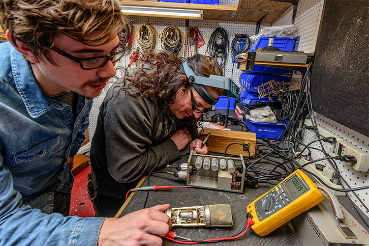 Technicians repairing equipment at Vintage King Audio in Ferndale