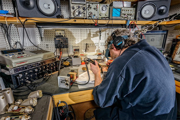 A technician repairing equipment at Vintage King Audio in Ferndale