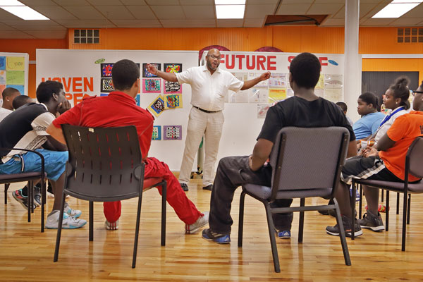 Frank McGhee, director of NSO YIP, mentoring a group of young Detroit men